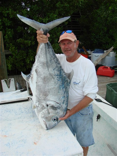 Captain Dan with an African Pompano - one of the many species that frequent the Florida Keys.